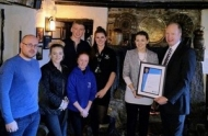 Jamaica Inn is presented with an award for helping snow-bound motorists